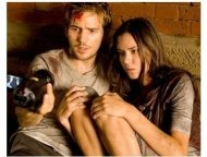 "Michael Stahl-David and Odette Yustman star in ""Cloverfield"""