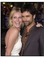 """Rebecca Romijn-Stamos and John Stamos at the """"X2: X-Men United"""" premiere"""