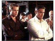 Oceans Eleven movie still: Brad Pitt and George Clooney