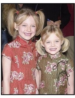 "Dakota Fanning and sister Elle at the ""Dr. Seuss' Cat in the Hat"" premiere"