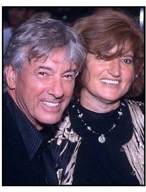 Paul Verhoeven and date at the Hollow Man premiere